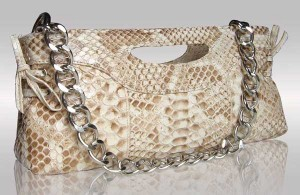 Beige color python leather clutche